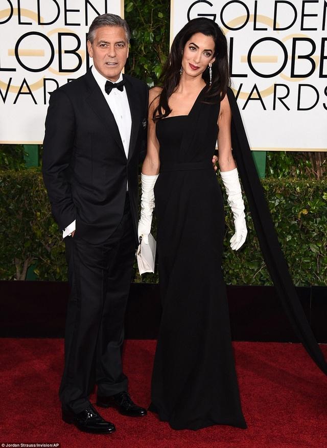 """Trước khi đến với Amal, George Clooney từng được xem là một trong những """"tay chơi có hạng"""" ở Hollywood."""
