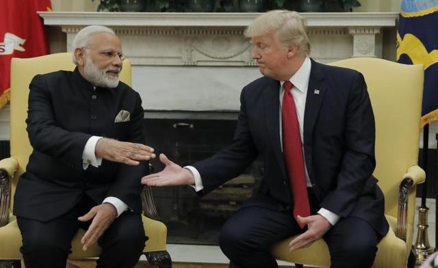 """Trong cuộc gặp mặt cấp cao lần đầu tiên, Thủ tướng Ấn Độ chia sẻ: """"Tôi đánh giá cao cam kết mạnh mẽ của Mỹ trong việc củng cố mối quan hệ song phương giữa 2 nước. Tôi chắc chắn mối quan hệ đối tác chiến lược đôi bên cùng có lợi giữa Mỹ và Ấn Độ sẽ ngày càng mạnh mẽ, bền chặt và vươn tới những đỉnh cao mới"""". (Ảnh: Reuters)"""