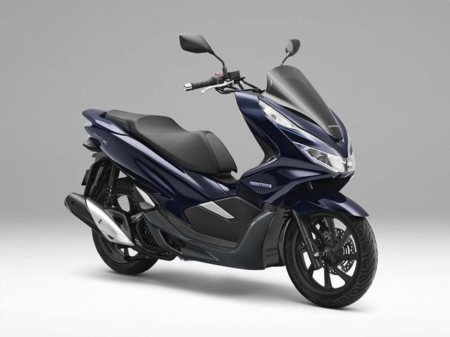 Honda ra mắt PCX dùng động cơ hybrid - 9