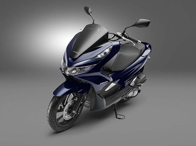 Honda ra mắt PCX dùng động cơ hybrid - 8