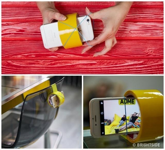 Cách làm tripod đơn giản với cuộn băng dính và dây chun.