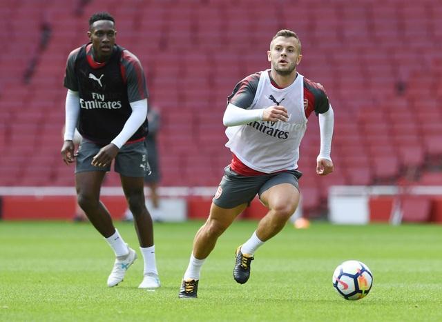 Tiền vệ Jack Wilshere (phải) đã trở lại Arsenal sau một năm tới Bournemouth theo dạng cho mượn