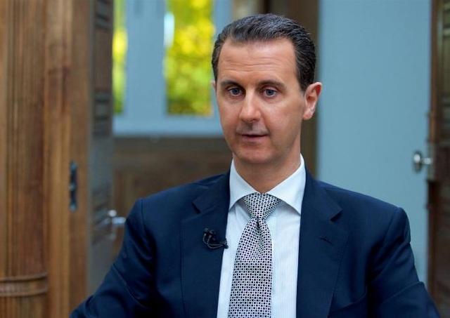 Tổng thống Syria Bashar al-Assad trong cuộc phỏng vấn với AFP hôm 13/4 (Ảnh: Reuters)
