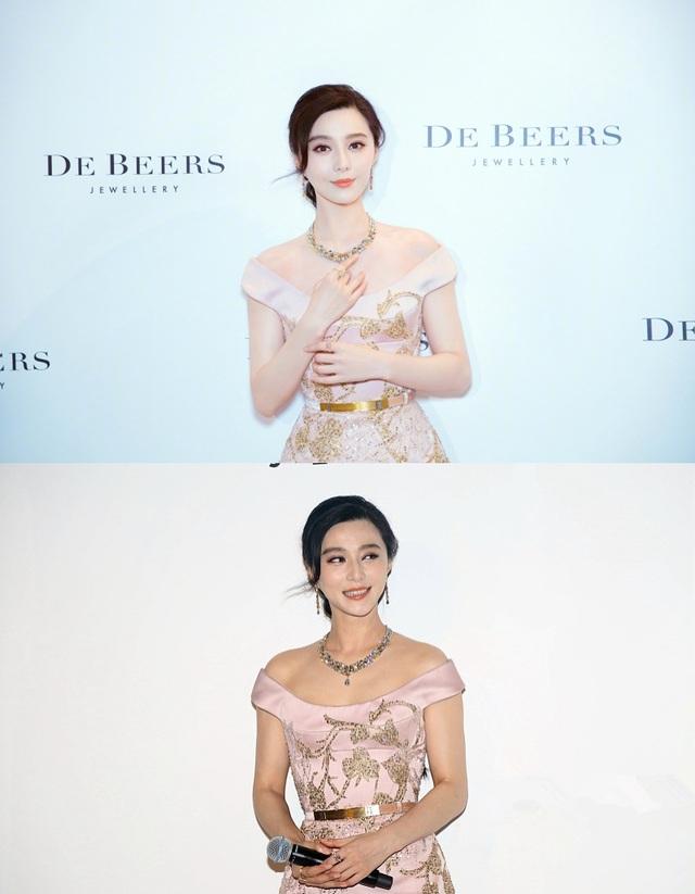 Phạm Băng Băng tham dự một sự kiện ở Bắc Kinh, Trung Quốc, tối 26/10. Người đẹp diện đầm trễ vai khoe bờ vai mịn màng và làn da trắng sứ đáng ngưỡng mộ.