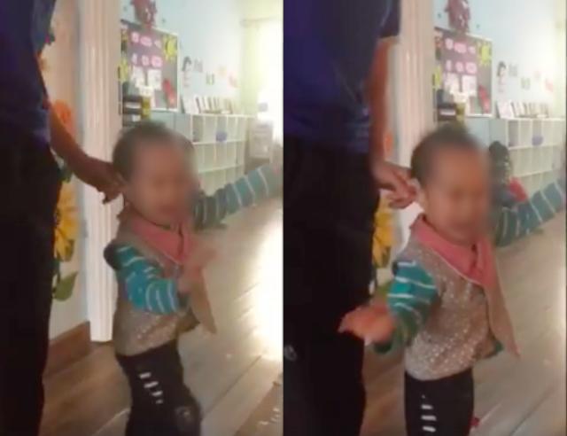 Sau khi thúc đầu gối vào ngực bé, cô giáo tiếp tục kéo tai (ảnh từ clip)