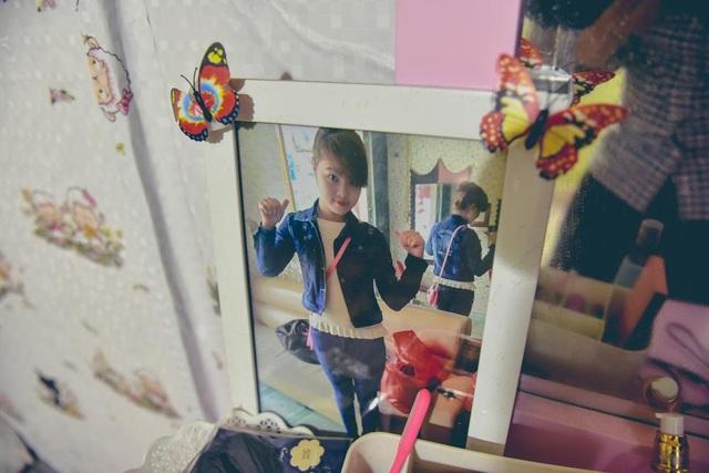 Những hình ảnh xinh đẹp của mình trước kia, được Dung treo cất kỹ trong phòng ngủ.