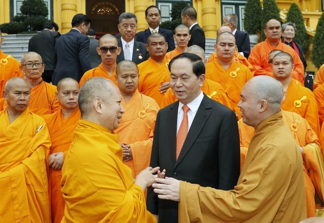 Chủ tịch nước Trần Đại Quang với các đại biểu tham dự buổi tiếp. Ảnh: Nhan Sáng-TTXVN