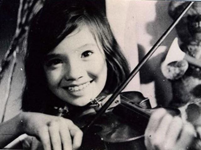 Nụ cười của em bé Lan Hương trong Em bé Hà Nội. Ảnh: TL.