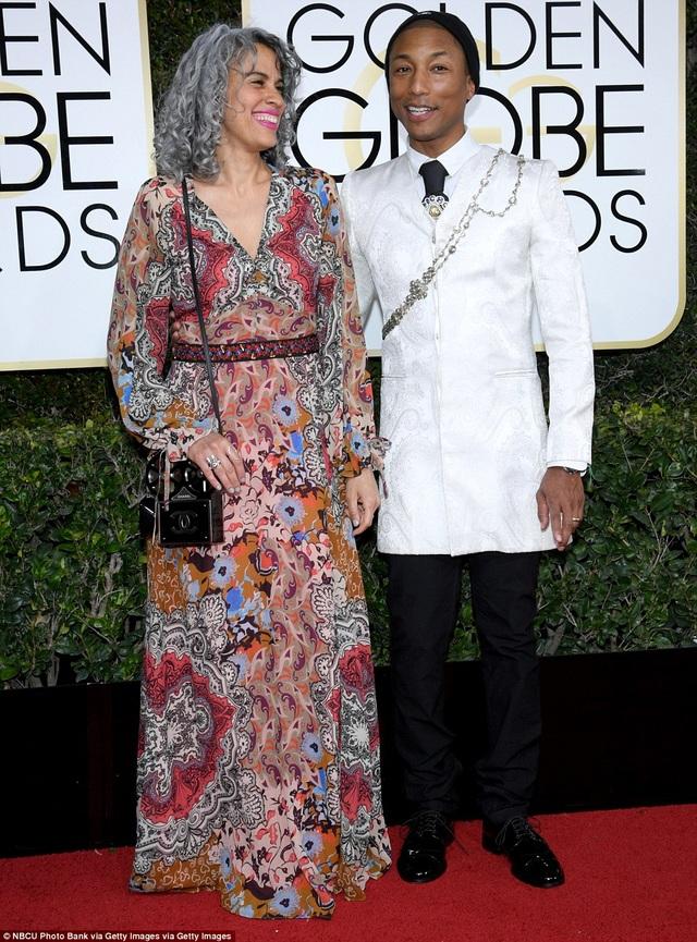Pharrell Williams và Mimi Valdés - cả 2 đều mặc quá lỗi mốt