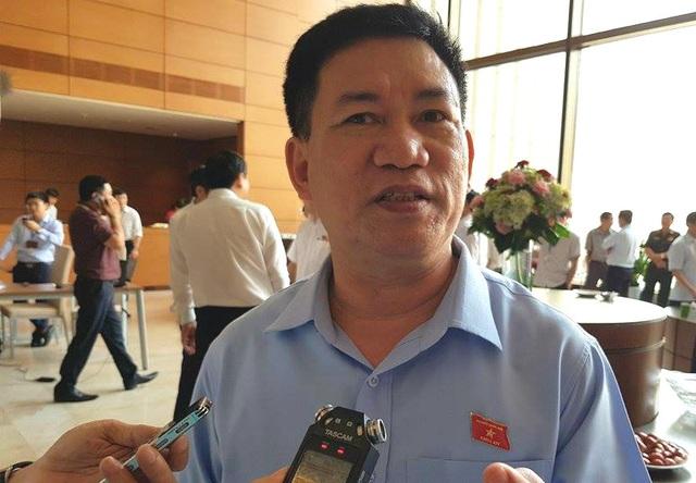 Ông Hồ Đức Phớc - Tổng Kiểm toán Nhà nước, đại biểu Quốc hội tỉnh Nghệ An trả lời báo chí sáng nay (1/6).