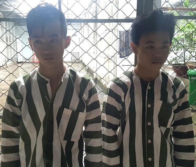 Trần Hoàng Vũ và Lê Quang Nghĩa tại cơ quan công an