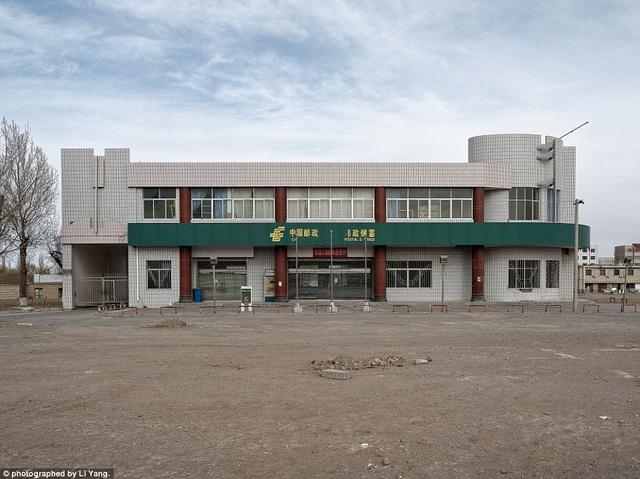 """""""Các bạn sẽ không tìm thấy thành phố này trên bất cứ bản đồ nào của Trung Quốc"""", nhiếp ảnh gia Li Yang, người hiện sống ở thủ đô Bắc Kinh, cách thành phố 404 khoảng 2.000km cho biết."""