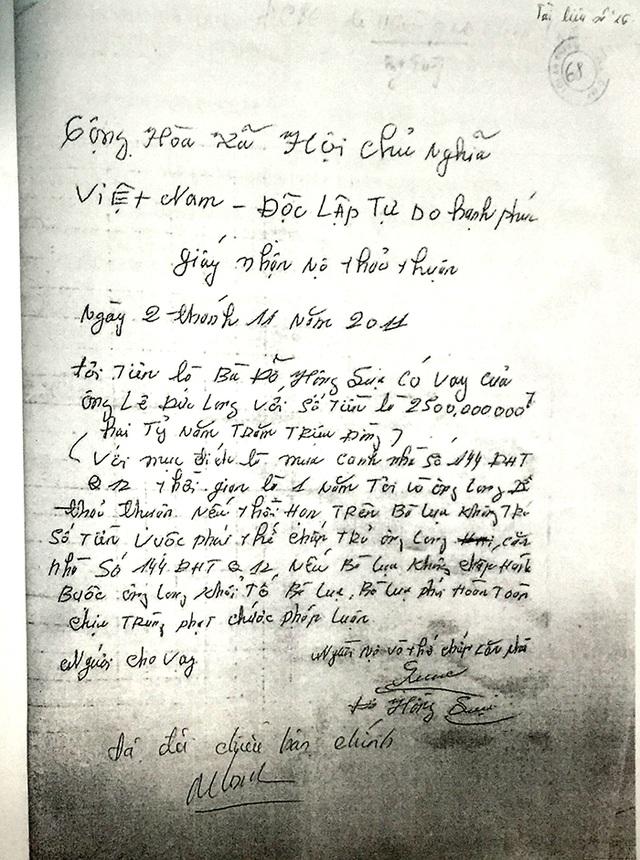 Mảnh giấy nhận nợ mà bà Lụa khẳng định đã bị chồng cũ dùng dao khống chế, ép buộc viết.