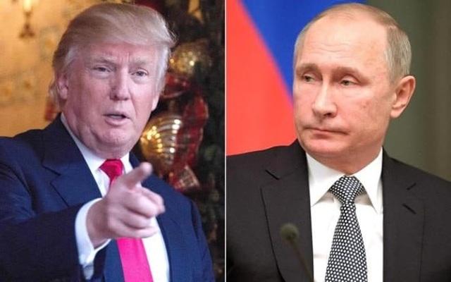 Tổng thống Nga Vladimir Putin (phải) và người đồng cấp Mỹ Donald Trump. (Nguồn: telegraph.co.uk)