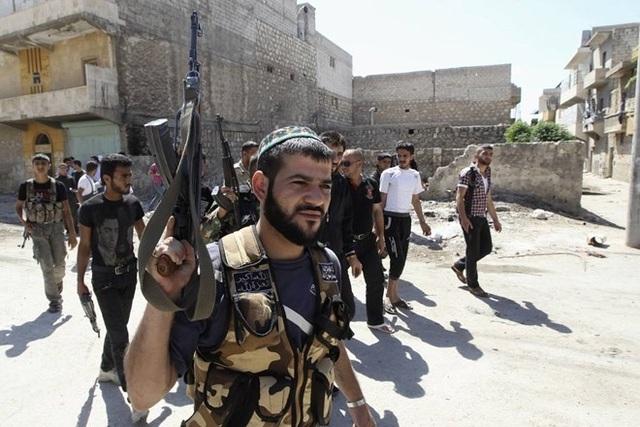 Một tay súng của nhóm phiến quân Ghuraba al-Sham. (Nguồn: Reuters)