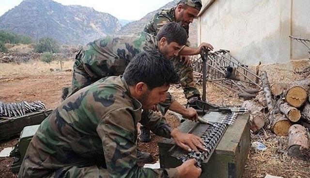 Các tay súng Hezbollah tại một cứ điểm quân sự ở khu vực biên giới Liban-Syria. (Nguồn: alalam.ir)