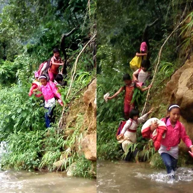 Thầy cô và học sinh đi qua khe núi trước khi vượt suối.
