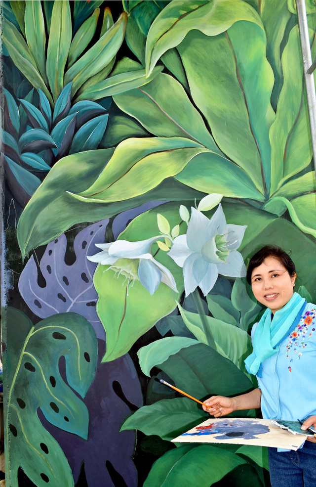 Bức tranh lấy màu xanh diệp lục và những họa tiết hoa lá nhiệt đới làm chủ đạo.