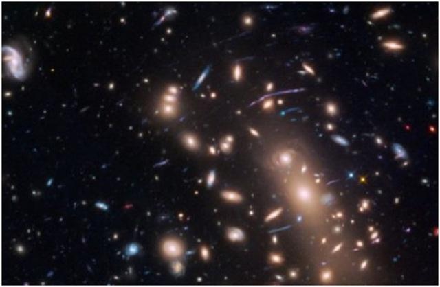 Những thiên hà nhỏ gọn mờ nhạt của vũ trụ sơ khai. Ảnh: NASA, ESA, và L. Infante (Pontificia Universidad Catolica de Chile)