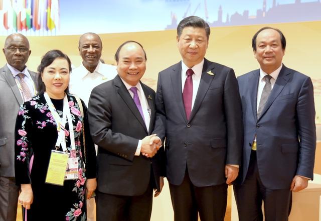 Thủ tướng Nguyễn Xuân Phúc và Chủ tịch Trung Quốc Tập Cận Bình gặp ngỡ ngày 8/7 (ảnh: VGP)