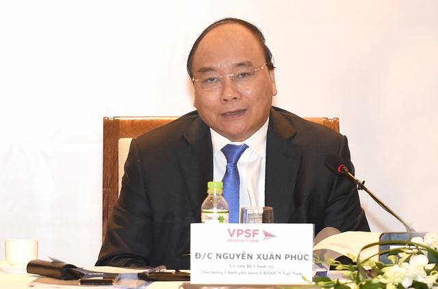 Thủ tướng Chính phủ Nguyễn Xuân Phúc phát biểu tại Diễn đàn Kinh tế tư nhân Việt Nam sáng 31/7. Ảnh: VGP/Quang Hiếu