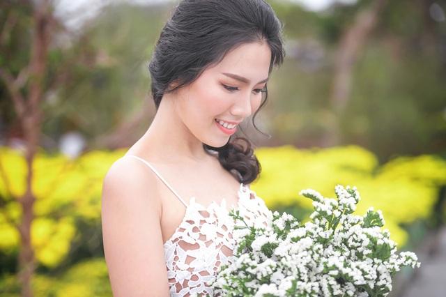 Nữ sinh tài sắc vẹn toàn khoe vẻ đẹp trong trẻo ngày Xuân - 7