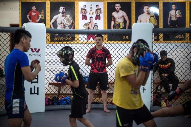 Xiao Wu, 14 tuổi, một thành viên của Enbo MMA cho biết cuộc sống tại cơ sở này thậm chí còn tốt hơn so với ở nhà.