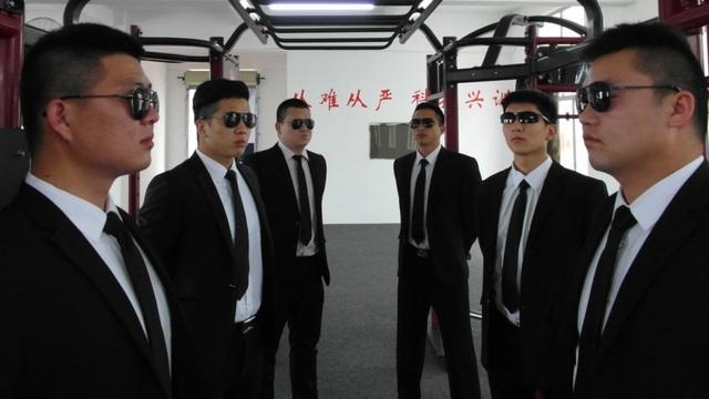 Vệ sĩ thuộc công ty Zhongzhou. (Ảnh: SCMP)