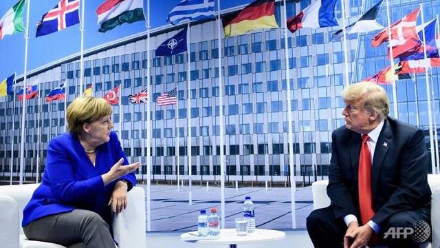 Thủ tướng Đức Angela Merkel và Tổng thống Mỹ Donald Trump (Ảnh: AFP)