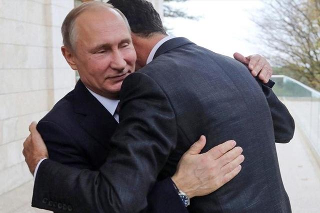 Tổng thống Nga Vladimir Putin và Tổng thống Syria Bashar al-Assad. Ảnh: AP