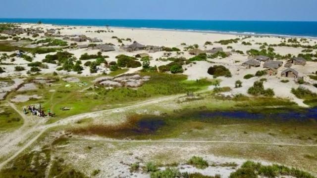 Quang cảnh ngôi làng sau khi bị tàn phá bởi lũ quét (Ảnh: Tổ chức Ân xá Quốc tế)