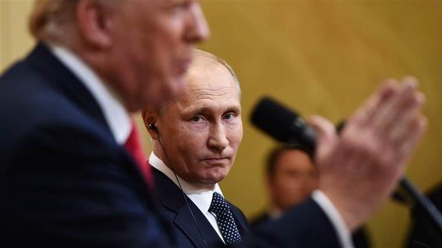 Tổng thống Vladmir Putin trong cuộc gặp với người đồng cấp Mỹ Donald Trump tại Phần Lan hồi tháng 7 (Ảnh: NBC)