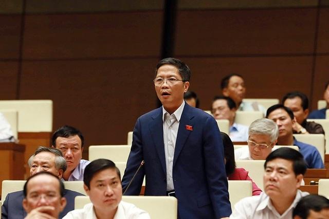 Bộ trưởng Công Thương Trần Tuấn Anh khẳng định không có lợi ích nhóm trong xử lý 12 dự án thua lỗ. (Ảnh Như Phúc)