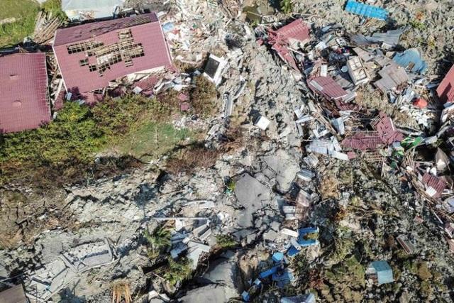 Hiện tượng đất hóa lỏng do động đất đã chôn vùi nhiều người và nhà cửa ở Sulawesi. (Ảnh: Straits Times)