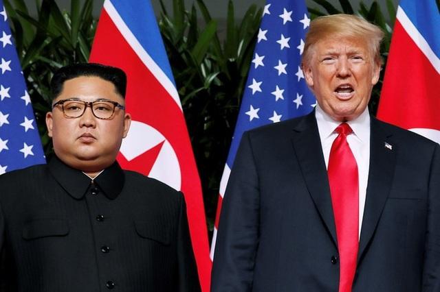 Tổng thống Donald Trump và nhà lãnh đạo Kim Jong-un gặp nhau tại Singapore hồi tháng 6. (Ảnh: Reuters)