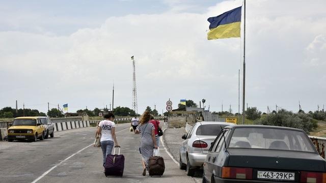 Quan hệ Nga-Ukraine căng thẳng sau khi Nga nhận sáp nhập bán đảo Crimea hồi tháng 3/2014. (Ảnh minh họa: RIA)