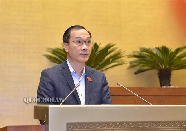 Chủ nhiệm UB Kinh tế Vũ Hồng Thanh thay mặt UB Quốc hội trình bày báo cáo giải trình, chỉnh lý dự thảo luật