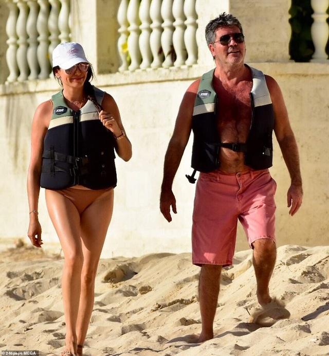 Simon Cowell và Lauren Silverman đang đi nghỉ cùng con trai chung của họ tại Barbados.