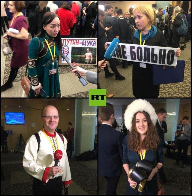 Mỗi nhà báo chọn một loại trang phục và biểu ngữ với hy vọng có thể được ông Putin chú ý.