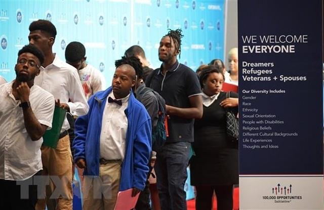 Tỷ lệ thất nghiệp tại Mỹ giảm xuống sát mức đáy trong 49 năm - Ảnh 1.