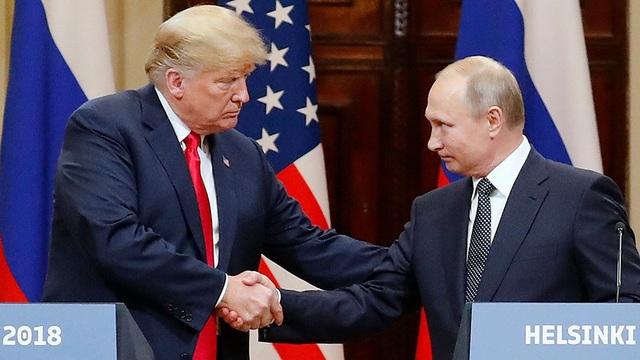 """Mỹ """"rút chân"""" khỏi các điểm nóng: """"Món quà"""" dành cho Tổng thống Putin? - Ảnh 1."""