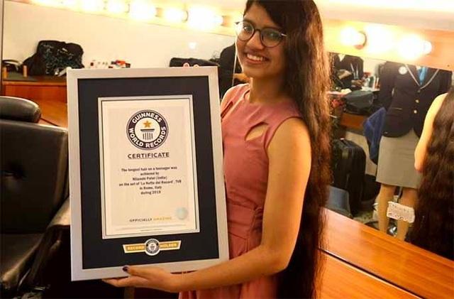 Thiếu nữ 16 tuổi lập kỷ lục thế giới với mái tóc dài như công chúa Disney - Ảnh 1.