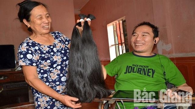 Chàng trai khuyết tật Nguyễn Minh Nhật: Chỉ một ngón tay, thay đổi... số phận - Ảnh 1.