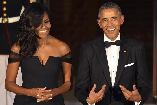 Vợ chồng ông Obama được yêu thích nhất nước Mỹ - Ảnh 1.