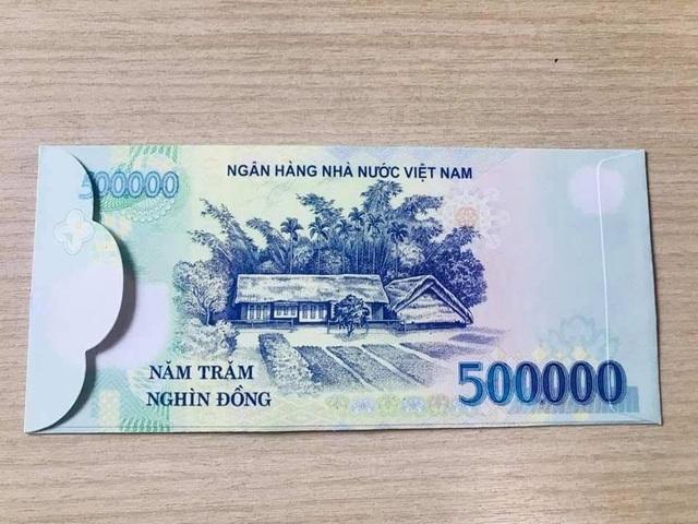Bao lì xì bằng tiền 500 ngàn đồng gây sốt thị trường Tết - Ảnh 1.