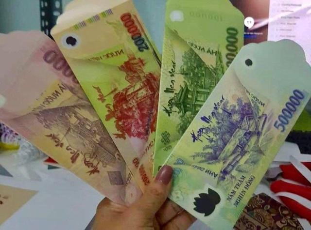 Bao lì xì bằng tiền 500 ngàn đồng gây sốt thị trường Tết - Ảnh 2.