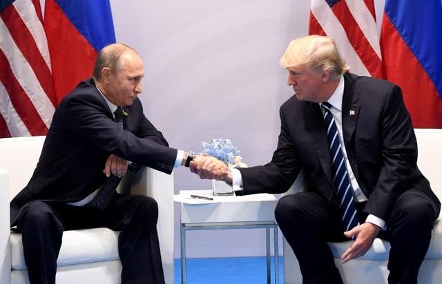 Tổng thống Trump và Tổng thống Putin gặp nhau lần đầu hồi tháng 7 năm ngoái tại Đức. (Ảnh: Reuters)
