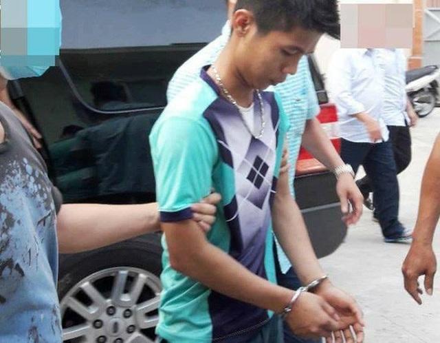 Nghi phạm Nguyễn Hữu Tình thời điểm bị trinh sát bắt giữ