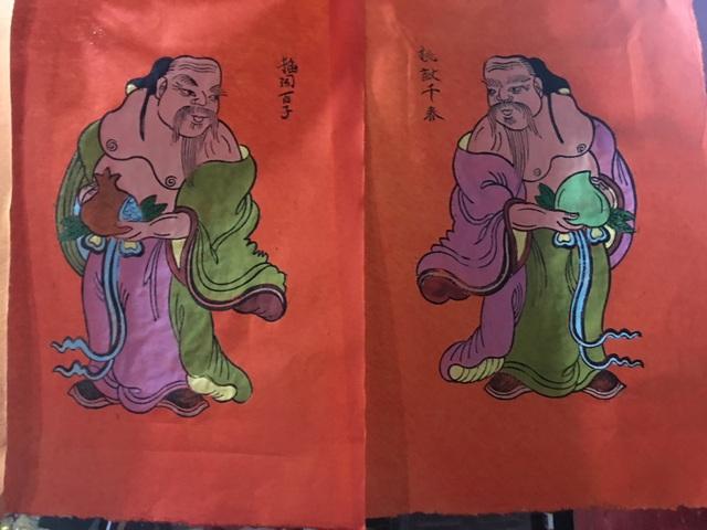 Tranh Kim Hoàng là sự kết tinh những nét độc đáo của tranh Hàng Trống và tranh Đông Hồ. Ảnh: Tùng Long.