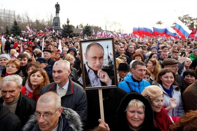 Tổng thống đương nhiệm Putin được dự đoán sẽ chiến thắng áp đảo trong cuộc bầu cử. (Ảnh: Reuters)